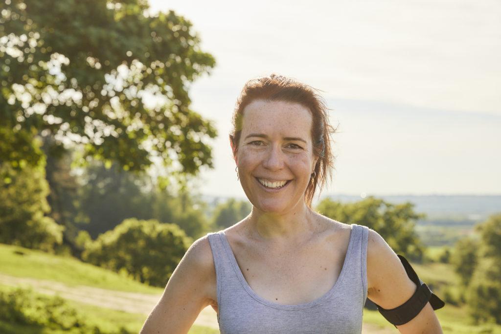 Women in grey running top smiling