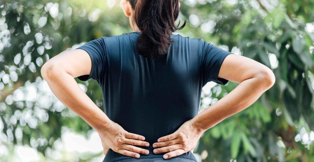 women holding her lower back